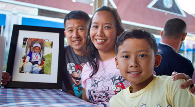 (L to R) John, Tricia and Justin Nguyen are dedicated to supporting cancer research, in honor of the memory of their son and brother, Timothy.