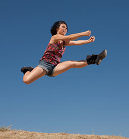 Jennifer soars during a jump that she does as a cheerleader. She underwent surgery to battle a rare bacterial infection that was attacking her heart.